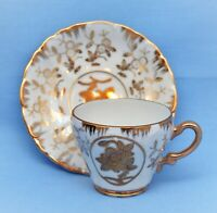 VINTAGE STERLING CHINA DEMITASSE CUP AND SAUCER SET WHITE GOLD