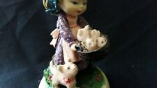Cuddles Collectible Keepsake figurine with girl holding basket of kittens