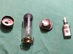 BELL & HOWELL FILMO DIPLOMAT (16mm projector bulb, housing, oil can, parts)