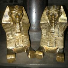 A PAIR OF BRASS SPHINX ANDIRONS/FIRE-DOGS/FIRE FENDERS