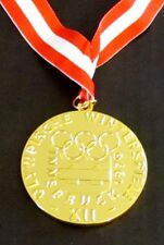 GOLD MEDAL - 1976 INNSBRUCK AUSTRIA OLYMPICS - WITH SILK RIBBON & STORAGE POUCH