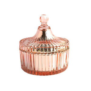 CAROUSEL - MEDIUM ROSE GOLD RIBBED GLASS JAR WITH LID.