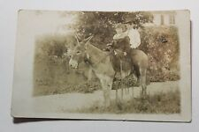 RPPC REAL PHOTO POSTCARD 1900 2 CHILDREN RIDING DONKEY TO SCHOOL