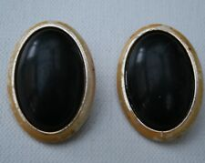 Pair of Retro Oval Clip On Mottled Cream Earrings with Black Centres
