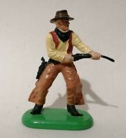 E**  BRITAINS DEETAIL Cowboy 2nd series light brown chaps with rifle.