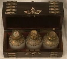 Antique rosewood dome top perfume box, with three opaque white glass bottles.