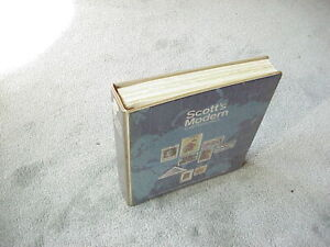 Scotts worldwide stamp album with a few stamps