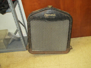 VINTAGE MODEL T FORD RADIATOR  W PEERLESS SHROUD ??