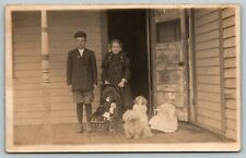 RPPC Bro & Sis on Porch w/4* Well-Dressed Dollies~Little Shaggy Dog to Boot~1910