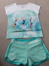 GYMNASTIC TWO PIECE TSHIRT/SHORT SET FROM JUSTICE IMPORTED FROM USA SIZE 9/10 (F