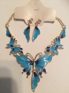 Necklace earring set:Blue and Navy Enamel. Rhinestones. Goldplated. Boxed