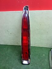 1994 - 1999 Cadillac Deville FWD  LH driver side tail light and chrome bezel OEM