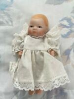 Beautiful Vintage Taiwan ROC Porcelain Baby Doll in Polka Dot Lace Pinafore