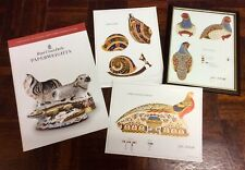 Three Pieces Of Royal Crown Derby Paperweight Artwork With Book