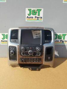 2013-2014 DODGE RAM 1500 2500 RADIO DASH BEZEL SURROUND WITH WOODGRAIN 14 15 16
