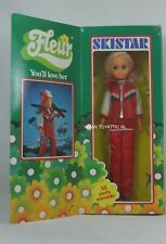 Fleur ( dutch Sindy ) doll skistar with dark blond hair in red skiing fashion