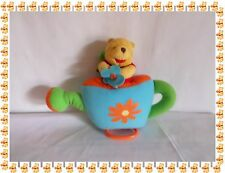 L - Doudou Musical Winnie dans un Arrosoir Fleurs Disney Baby