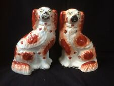 Antique porcelain pair of Staffordshire dogs.