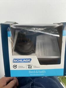 Schlage Accent Door Lever Bed & Bath Aged Bronze New Construction Privacy