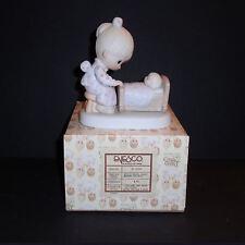 Precious Moments Porcelain Figurine: The Hand That Rocks The Future #E-5204