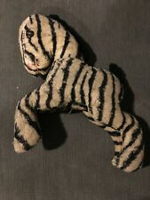 Vintage/Antique stuffed zebra, button eyes. Shows wear. Sold as is. As pictured.
