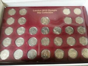 2 full sets of Olympic 50p's with completer in tray