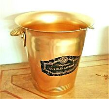 Seau à Champagne en métal doré des années 1980 environ.