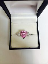AVON FANCY SHAPE CZ AND TRILLION PINK HEART RING
