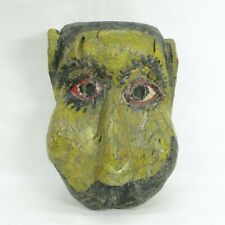C263: Really old colored wooden biggish mask of very interesting face