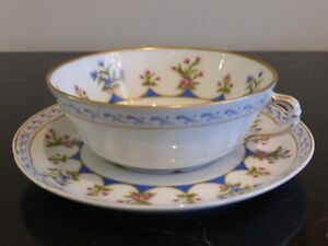 BERNARDAUD LIMOGES CHATEAUBRIAND FOOTED CUP AND SAUCER