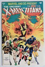 ESS100. THE UNCANNY X-MEN & THE NEW TEEN TITANS #1 DC & Marvel 9.0 VF/NM (1982)~
