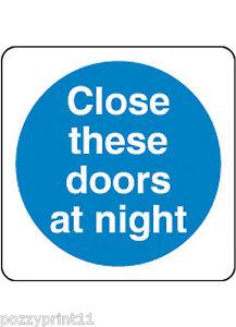 CLOSE THESE DOORS AT NIGHT SIGN