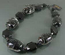 GABYS CHUNKY STATEMENT NECKLACE WITH BLACK MURANO AND FACETED GLASS BEADS.