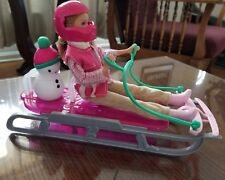 Stacie doll and sled