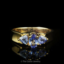 Oval Cut and Trillion Cut Tanzanite Ring in 14k Gold Cathedral Mounting