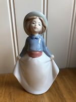 NAO By Lladro  GIRL PICKING UP HER SKIRT 02001290 Perfect