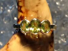 9ct GOLD THREE STONE PERIDOT SET RING - SIZE M - 2108.09