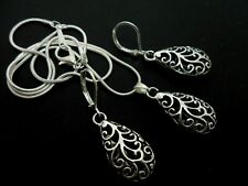 A TIBETAN SILVER TEARDROP THEMED NECKLACE AND LEVERBACK EARRING SET. NEW.