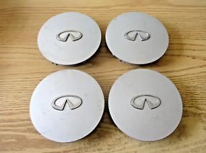 Factory original 1990 to 1992 Infiniti M30 alloy wheel center caps hubcaps