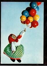 1966 Russian doll girl lifted by balloons Russia postcard