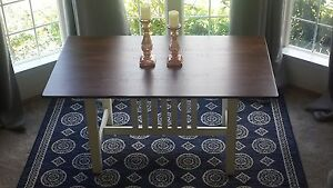 Darvern cottage dining table. Farm style antique white base dark stained top.