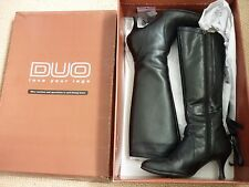 Leather heeled boots by DUO, size 2.5