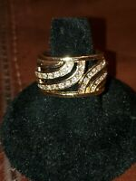 Size 8. DIAMONIQUE ETERNITY 14K LAYERED GOLD  BAND. ROUND STONES.