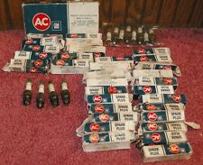 7 Full Sets of 8 New Old Stock AC R46TX Spark plugs Green Stripe