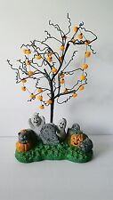 halloween tree with pumpkin ornaments and hand painted base
