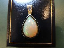 Superbe pendentif opale cabochon or 18 carats et diamant