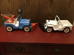 """Vintage Tonka Jeeps AA Blue Wrecker W/Plow And White W/Plow 1960's 13"""" And 11""""."""