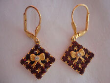 Goldplated bow prongset deep red crystal 4gram 38mm drop pierced safety earrings