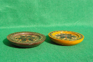 Two turned decorated and brass inlaid hardwood coasters from Poland