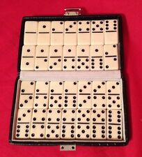 Travel Dominos in a little black case white with black dots 28 dominos